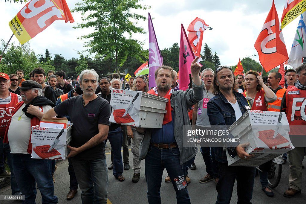 People carry boxes containing a petition against the labour reforms during a demonstration against the controversial reforms, on June 28, 2016 in Rennes. Unions have called repeated strikes and marches in opposition to the law, which seeks to bring down France's intractable 10-percent unemployment rate by making it easier to hire and fire workers.