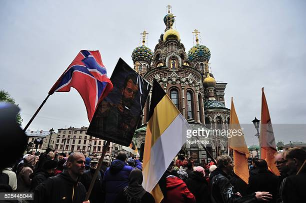 People carry icons and flags in the cross procession dedicated to the birthday of Nicholas II the last Emperor of Russia SaintPetersburg Russia 19...