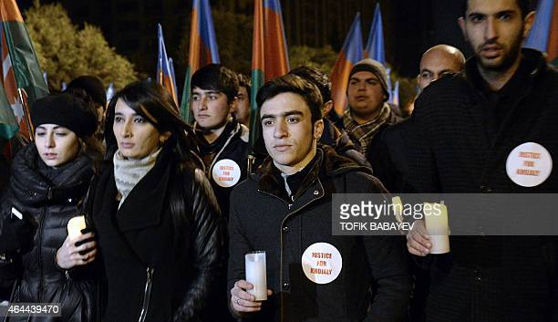 People carry lit candles as they gather in central Baku on February 25 2015 to commemorate the Khojaly massacre in 1992 in which ethnic Azerbaijanis...