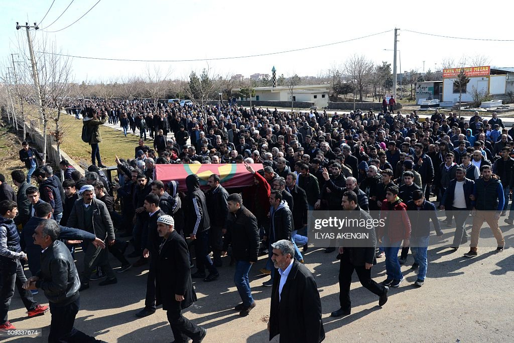 People carry on February 10, 2016 in Diyarbakir the coffin of 16-year-old Mahmut Bulak, who was killed during a protest against operations in Cizre on February 9. Cizre has been under a controversial curfew for six weeks as the Turkish army pursues a relentless campaign against rebels of the PKK which activists claim has cost dozens of civilian lives. / AFP / ILYAS AKENGIN