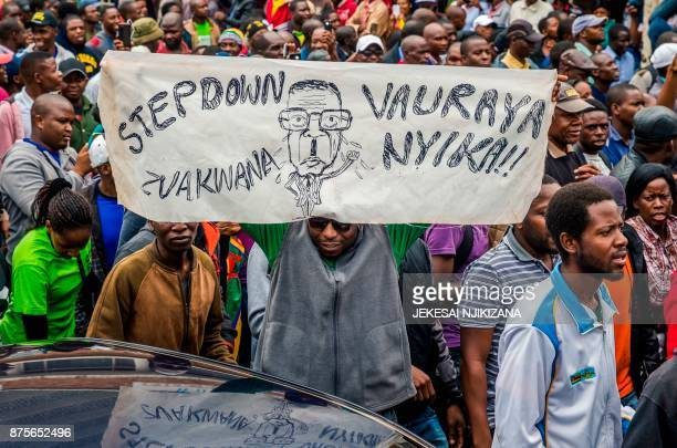 People carry placards during a demonstration demanding the resignation of Zimbabwe's president on November 18 2017 in Harare Zimbabwe was set for...