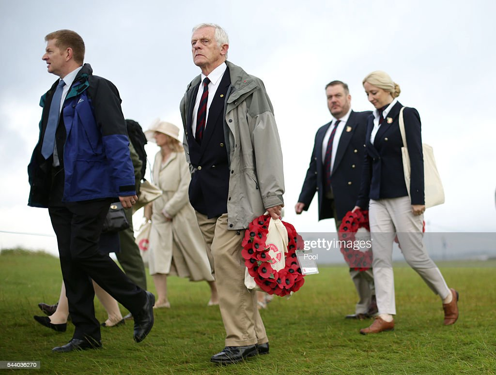 People carry poppy wreaths ahead of the 100th anniversary of the beginning of the Battle of the Somme at the Thiepval memorial to the Missing on July 1, 2016 in Thiepval, France. The event is part of the Commemoration of the Centenary of the Battle of the Somme at the Commonwealth War Graves Commission Thiepval Memorial in Thiepval, France, where 70,000 British and Commonwealth soldiers with no known grave are commemorated.