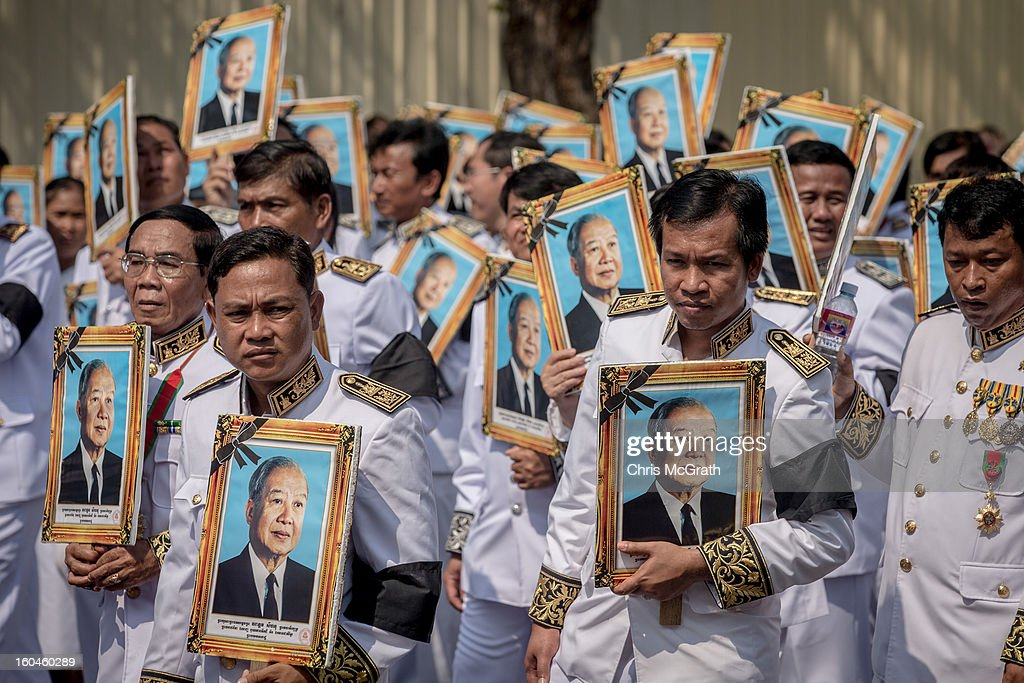 People carry portraits of former King Norodom Sihanouk during the funeral procession on February 1, 2013 in Phnom Penh, Cambodia. Over half a million mourners lined the streets to pay their respects during the funeral procession which finished at the crematorium where his funeral pyre will be lit by his wife and son on the 4th of February. King Norodom Sihanouk died of a heart attack last October in Beijing at the age of 89. For the past three months his body has been lying in state at the Royal Palace.