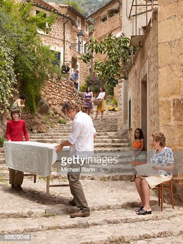 People carry table down steps : Stock Photo