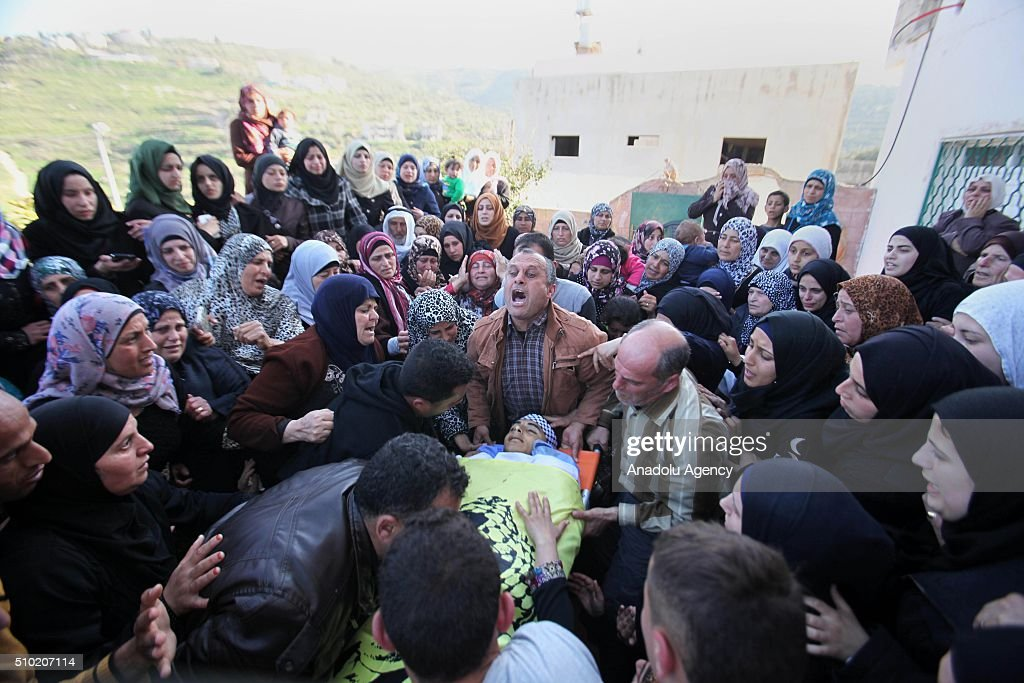 People carry the bodies of 2 15-year-old Palestinian teenagers, namely Nihad Raid and Fuad Mervan, who have been killed by Israeli soldiers, during the funeral ceremony at El-Arka town of Jenin, West Bank on February 14, 2016.