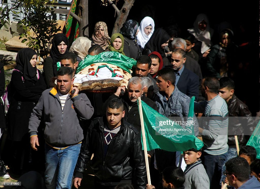 People carry the body of 17-year-old Palestinian girl Kalzar El-Uveivi, who has been killed by Israeli soldiers in alleged knife attack, during her funeral ceremony in Hebron, West Bank on February 14, 2016.