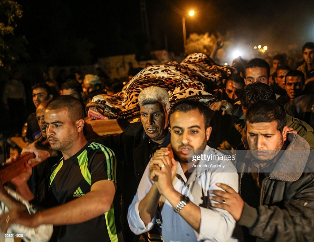 People carry the body of Zine al-Umur, 55, who lost her life after Israeli warplanes bombed around Gaza's southern, during a funeral ceremony in east of the Rafah city, Gaza on May 5, 2016.