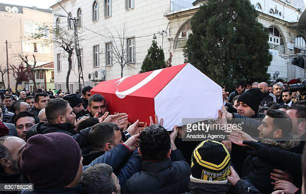 People carry the coffin of 35yearsold security guard Fatih Cakmak during his funeral prayer service on January 02 2017 at Yavuz Selim Mosque in...