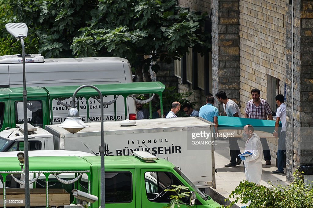 People carry the coffin of a victim of a bombing to a hearse at the forensic building close to Istanbul's airport on June 29, 2016, a day after a triple suicide bombing at the international airport. The bombing left 41 people dead and 239 wounded, the city governor said in a statement. / AFP / OZAN