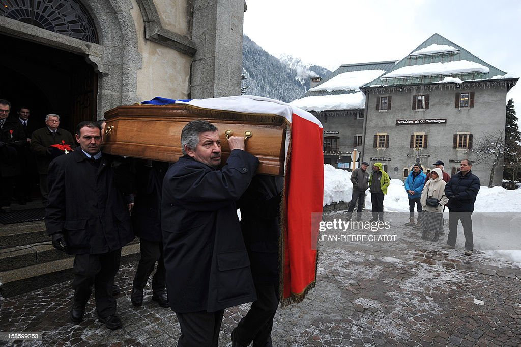 People carry the coffin of French climber Maurice Herzog after his funeral ceremony, on December 20, 2012 at the Saint-Michel church in Chamonix, French Alps. Maurice Herzog, the French climber who conquered Annapurna in the first recorded ascent of a peak above 8,000 metres, has died at the age of 93, on December 13.