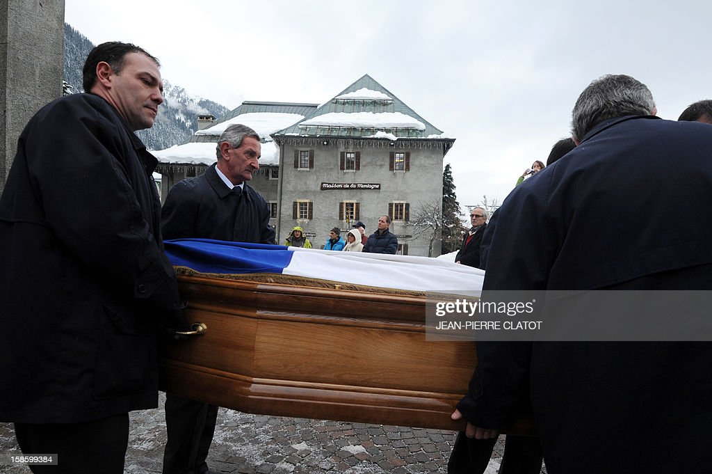 People carry the coffin of French climber Maurice Herzog after his funeral ceremony, on December 20, 2012 at the Saint-Michel church in Chamonix, French Alps. Maurice Herzog, the French climber who conquered Annapurna in the first recorded ascent of a peak above 8,000 metres, has died at the age of 93, on December 13. AFP PHOTO JEAN-PIERRE CLATOT