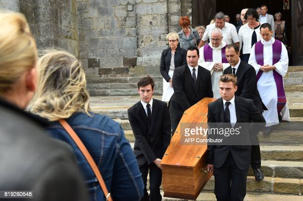People carry the coffin of French judge JeanMichel Lambert at the end of his funeral at the SaintJulien Cathedral in Le Mans northwestern France on...