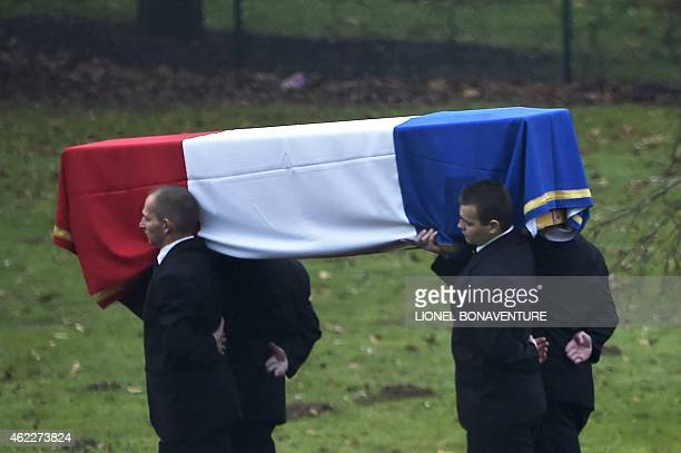 People carry the coffin of Herve Gourdel the French tourist who was kidnapped and beheaded by jihadists in Algeria on January 26 at the Paris Charles...