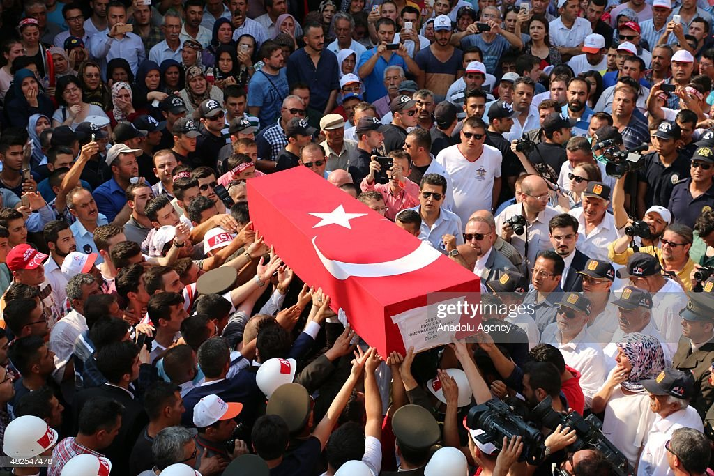 People carry the coffin of Infantry Kagan Kandemir one the three Turkish soldiers who was killed in a terror attack on a team of troops in Sirnak...