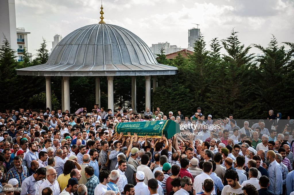 People carry the coffin of suicide attack victim Mohammad Eymen Demirci on June 29, 2016 in Istanbul during his funeral a day after a suicide bombing and gun attack targeted Istanbul's Ataturk airport, killing at least 36 people. Turkey pointed the finger of blame at Islamic State jihadists on June 29 after suicide bombers armed with automatic rifles attacked Istanbul's main international airport, killing 41 people, including foreigners. / AFP / OZAN