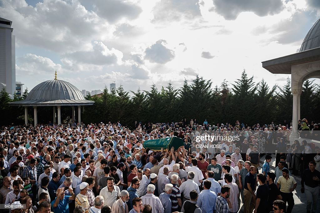 People carry the coffin of suicide attack victim Mohammad Eymen Demirci on June 29, 2016 in Istanbul during his funeral a day after a suicide bombing and gun attack targeted Istanbul's Ataturk airport, killing 41 people. Turkey pointed the finger of blame at Islamic State jihadists on June 29 after suicide bombers armed with automatic rifles attacked Istanbul's main international airport, killing 41 people, including foreigners. / AFP / OZAN