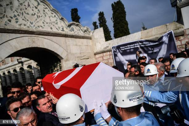 People carry the coffin of Turkey's legendary triple Olympic goldmedal winning weightlifter Naim Suleymanoglu during his funeral cerenomy in Istanbul...