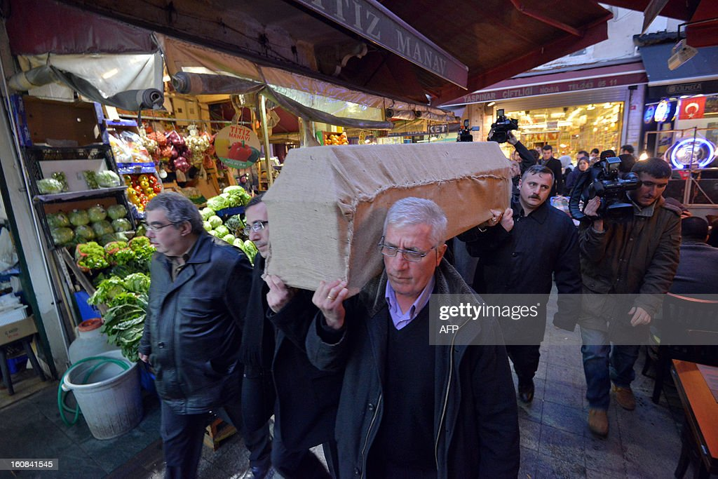 People carry the coffin of US tourist Sarai Sierra, 33, at Beyoglu in Istanbul on February 6, 2013 whose remains will be flown out of Turkey on February 7. Sierra went missing on January 21, three weeks after she arrived in Istanbul and a day before she was expected to return home. Reports state that Sarai Sierra who was on holiday alone in Istanbul was killed by at least one fatal blow to the head, Turkish officials said.