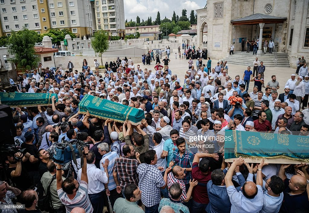 People carry the coffins of Maryam Amiri, Karime Amiri, Zahra Amiri and Huda Amiri on June 30, 2016 during their funerals two days after they were killed by a suicide bombing and gun attack targeted Istanbul's Ataturk airport, killing 42 people. The death toll from the triple suicide bombing and gun attack that occurred on June 28, 2016 at Istanbul's Ataturk airport has risen to 43 including 19 foreigners. The government has pointed the finger of blame at the Islamic State group and Turkish police rounded up 13 suspected IS jihadists in raids at 16 different locations across Istanbul on June 30. KOSE