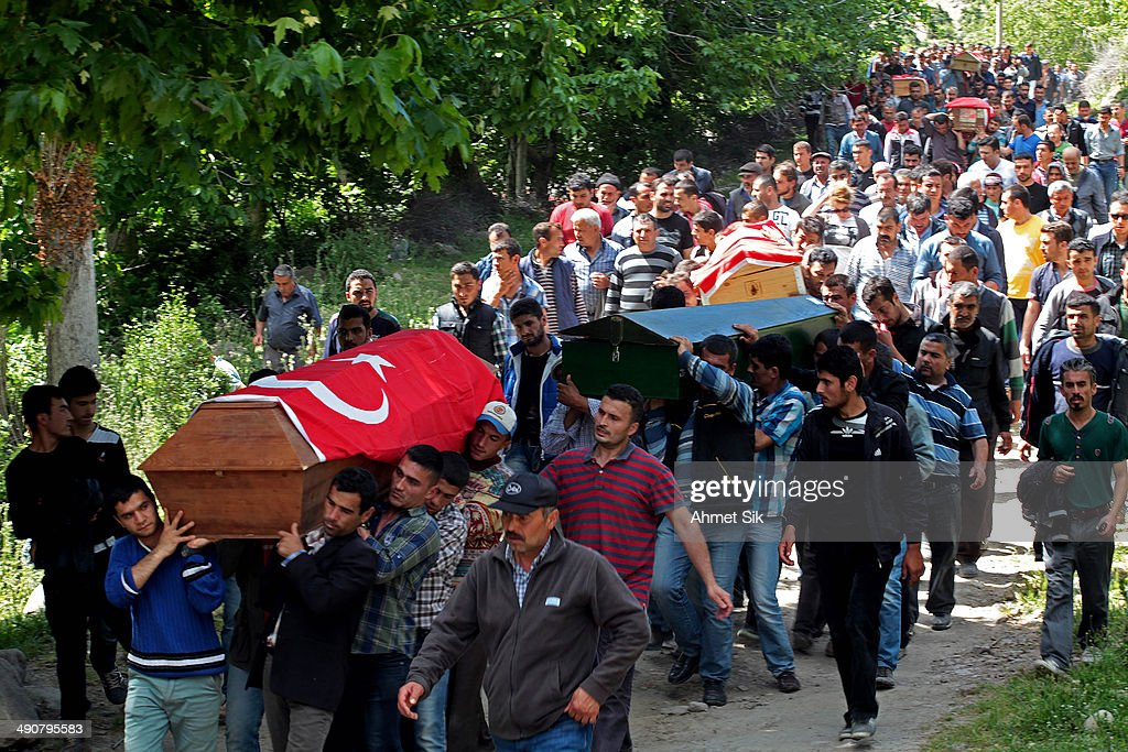 People carry the coffins of the miners to the cemetery after a mining disaster on May 15 2014 in Soma a district in Turkey's western province of...