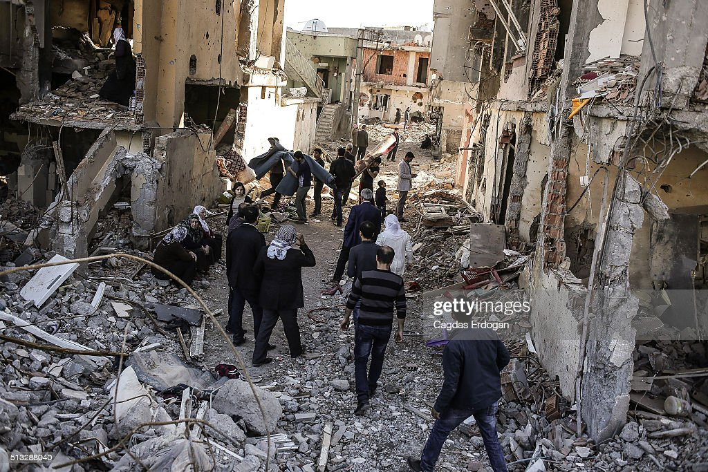 People carry their belongings from their ruined houses in Cizre March 2 Turkey Turkish authorities scaled down a 24hour curfew imposed on the mainly...