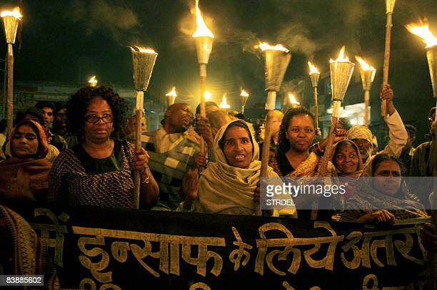 People carry torches during a march to mark the 24th anniversary of the Bhopal Gas Tragedy in Bhopal on December 2 2008 The march was taken to...