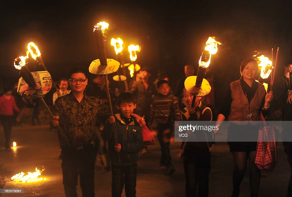 People carry torches through the streets to wish good luck in the New Year during the Spring Festival on February 18, 2013 in Jinjiang, Fujian Province of China. The Chinese Lunar New Year also known as the Spring Festival, which is based on the Lunisolar Chinese calendar, is celebrated from the first day of the first month of the lunar year and ends with Lantern Festival on the Fifteenth day. 2013 is the Year of the Snake according the 12-year cycle of animals which appear in the Chinese Zodiac.
