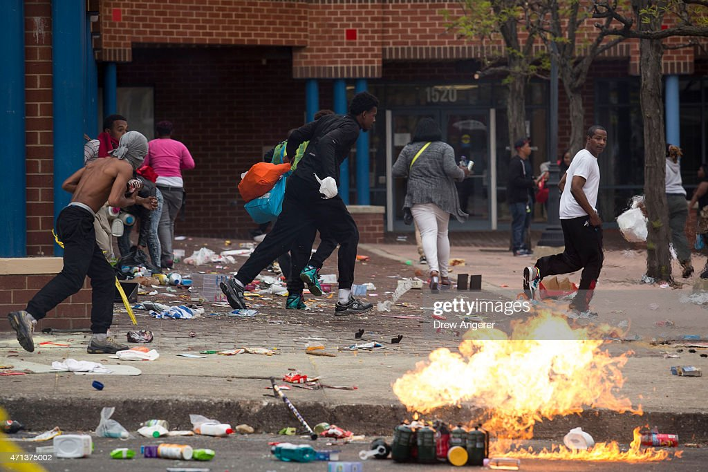 People carrying goods leave a CVS pharmacy near the intersection of Pennsylvania Avenue and North Avenue April 27 2015 in Baltimore Maryland Riots...