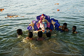 People carrying idol of lord ganesh immersed in pond on ganpati festival, Muthannankulam, Coimbatore, Tamil Nadu