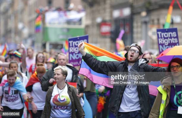 People carrying Trans rights banners take part in the Pride Glasgow parade through the city centre