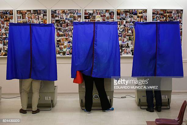 People cast their ballots in a polling station during the presidential primary election on April 26 2016 in Philadelphia Pennsylvania Five US states...