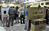 People cast their vote during legislative and municipal elections on March 1 2015 in San Salvador El Salvador voted Sunday in tightly contested...