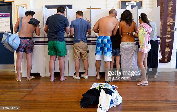 People cast their votes at a polling station at Sydney's Bondi Beach on September 7 in Australia's general election Latest polls show conservative...