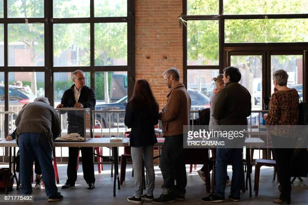 People cast their votes at a polling station in VillefranchedeLauragais near Toulouse on April 23 2017 during the first round of the French...