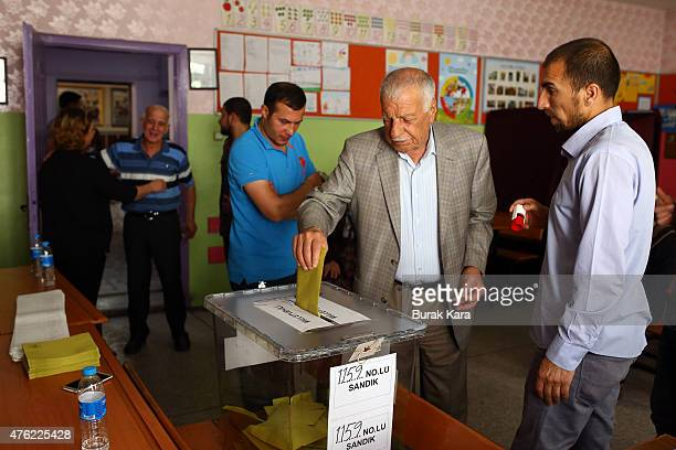 People cast their votes at a polling station polling station on June 7 2015 in Diyarbakir Turkey According to reports some 53 million Turkish people...