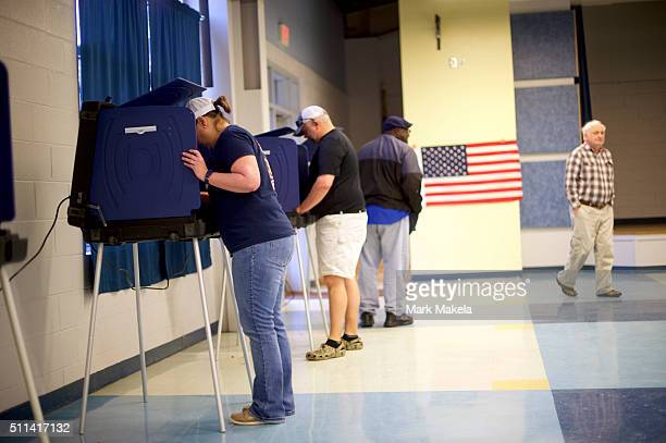 People cast their votes at the Forrest Middle School polling precinct on February 20 2016 in Walterboro South Carolina Statewide voters will cast...