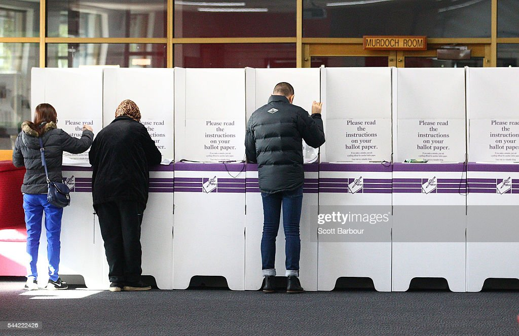 People cast their votes the national election at a polling station at Mount Alexander College on July 2, 2016 in Melbourne, Australia. Voters head to the polls today to elect the 45th parliament of Australia.