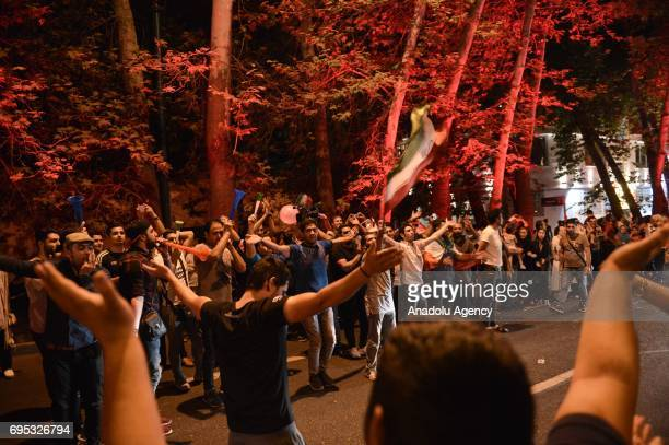 People celebrate after Iran qualifies for the 2018 FIFA World Cup by beating Uzbekistan at Azadi Stadium in Tehran Iran on June 13 2017