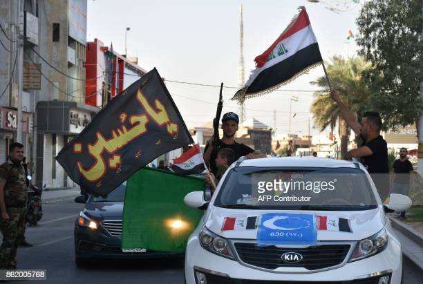 People celebrate after Iraqi forces advanced in Kirkuk during an operation against Kurdish fighters on October 16 2017 Iraqi forces seized the Kirkuk...