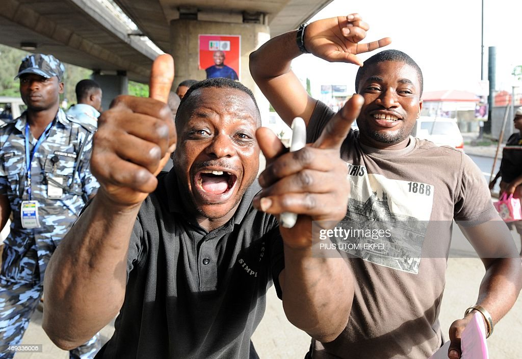 People celebrate after results of the gubernatorial and parliamentarian elections in Lagos on April 11 2015 Nigeria began counting votes from state...