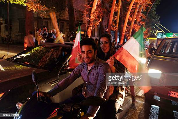 People celebrate after the 51 nuclear agreement was announced on Vali Asr Avenue on July 14 2015 in Tehran Iran The nuclear arms deal will reportedly...