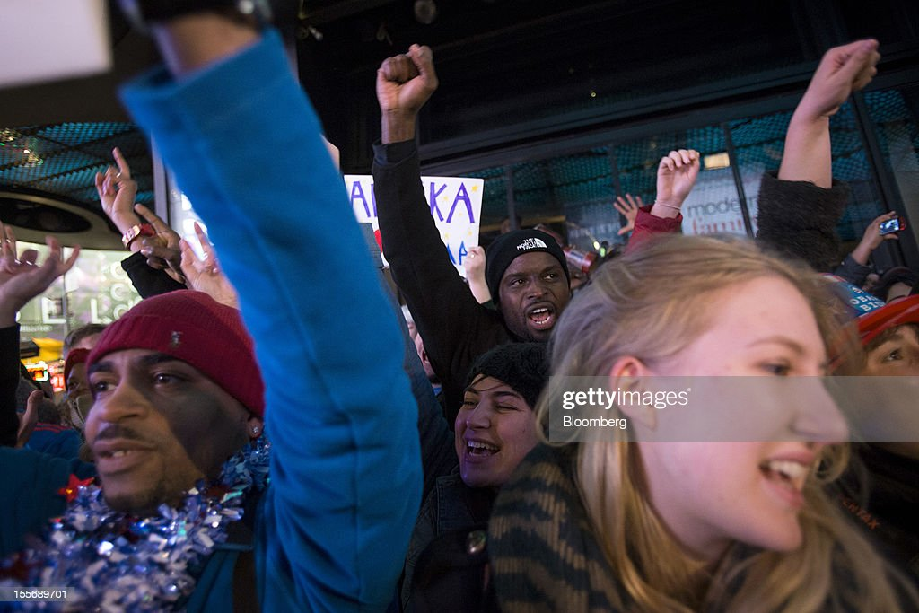 People celebrate after U.S. President Barack Obama was projected the winner of the presidential election at Times Square in New York, U.S., on Wednesday, Nov. 7, 2012. Barack Obama, the post-partisan candidate of hope who became the first black U.S. president, won re-election today by overcoming four years of economic discontent with a mix of political populism and electoral math. Photographer: Scott Eells/Bloomberg via Getty Images