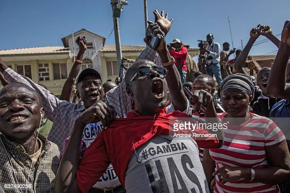 People celebrate as ECOWAS troops from Senegal gather outside the Gambian statehouse on January 23 2017 in Banjul The Gambia ECOWAS is in Gambia to...
