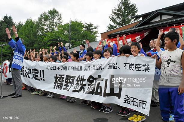 People celebrate as the former Hashino Furnace is registered as world heritage site on July 6 2015 in Kamaishi Iwate Japan Japan's 'Sites of the...