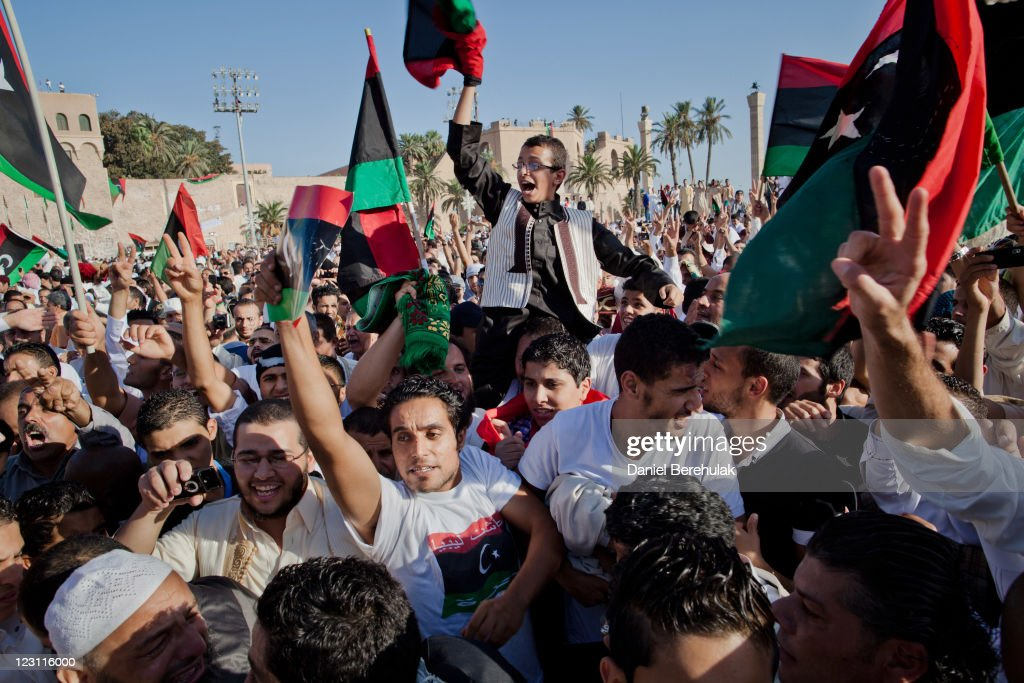 Libyan rebels sieze control of tripoli from gaddafi forces photos people celebrate as they gather at martyr square formerly known as green square for the sciox Choice Image