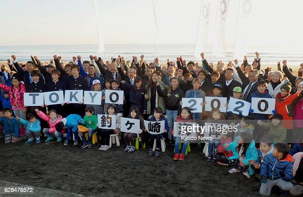 People celebrate at a beach in the town of Ichinomiya near Tokyo on Dec 8 after the International Olympic Committee decided that the surfing events...