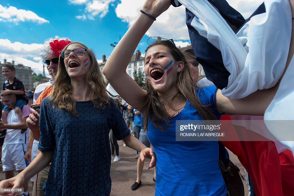 People celebrate at the Lyon's fanzone during the Euro 2016 football tournament match between France and Eire on June 26, 2016. / AFP / ROMAIN