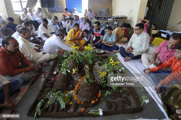People celebrating Govardhan Puja at Gaushala in Sector 94 on October 20 2017 in Noida India Goverdhan Puja or Annakut or Annakoot as it is also...
