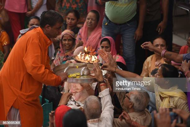 People celebrating Govardhan Puja at Jhandewalan Temple on October 20 2017 in New Delhi India Goverdhan Puja or Annakut or Annakoot as it is also...