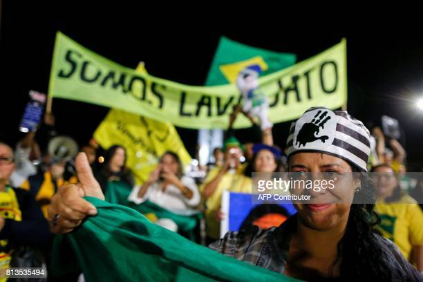People celebrate in Brasilia on July 12 after Brazil's former president Luiz Inacio Lula da Silva was sentenced to nearly 10 years in prison for...